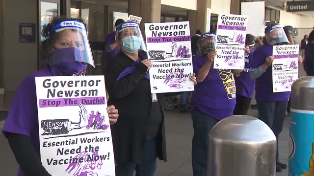 los angeles, ca, u.s. - essential workers holding posters during vaccine rally, at lax airport, on thursday, february 4, 2021. - western script stock videos & royalty-free footage
