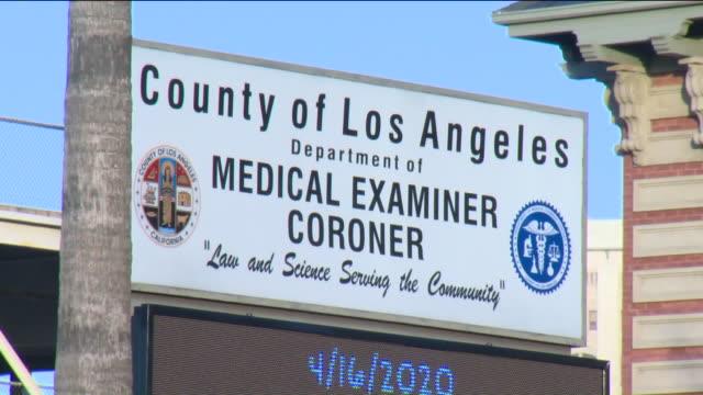 stockvideo's en b-roll-footage met los angeles, ca, u.s. - exteriors of los angeles county department of medical examiner-coroner on friday, april 17, 2020. - lijkschouwer