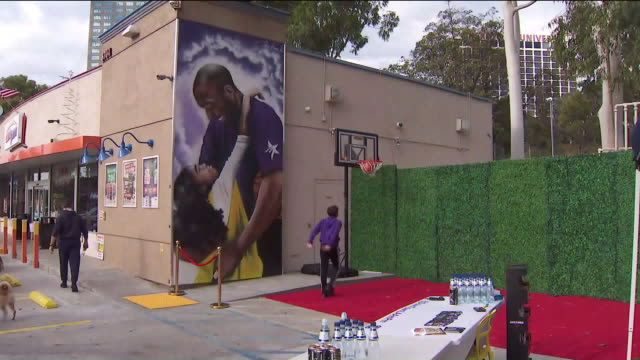 ktla los angeles ca us fans playing basketball next to kobe bryant mural at studio city neighborhood on friday february 21 2020 - female likeness stock videos & royalty-free footage