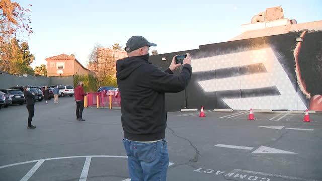 los angeles, ca, u.s. - fans taking photos in front of eddie van halen mural on wednesday, january 27, 2021. - male likeness stock videos & royalty-free footage