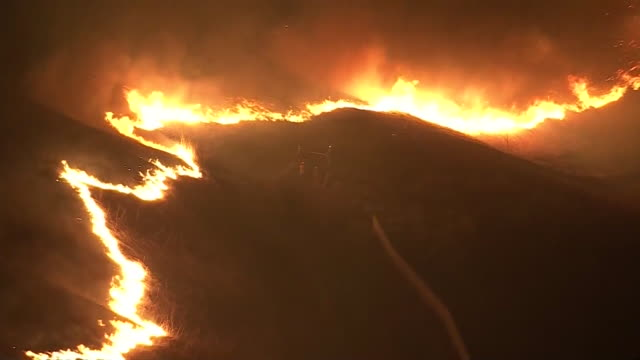 los angeles, ca, u.s. - firefighters approaching fire in yorba linda hit by blue ridge wildfire - drone view. fire crews battling the blue ridge fire... - western usa stock videos & royalty-free footage