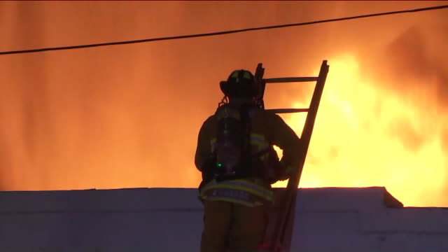 ktla los angeles ca us firefighters extinguishing fabric warehouse fire in arts district of los angeles on monday september 9 2019 - fire engine stock videos & royalty-free footage