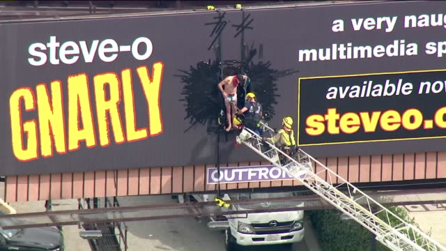 los angeles, ca, u.s. - firefighters rescuing steve-o from billboard, aerial view on thursday, august 13, 2020. - steve o stock videos & royalty-free footage