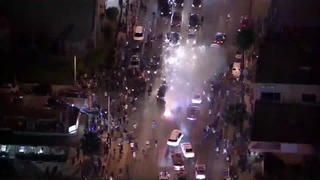 los angeles, ca, u.s. - fireworks on street blocked by fans celebrating dodgers winning world series - drone view. people were reveling in the... - baseball world series stock videos & royalty-free footage