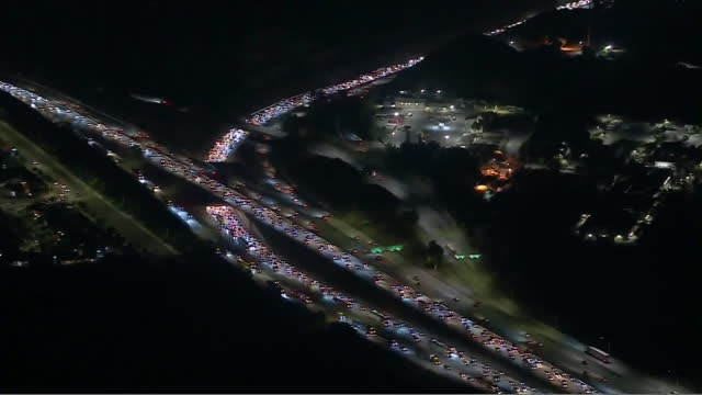 los angeles, ca, u.s. - heavy traffic on interstate 5, san fernando valley, aerial view on friday, may 2021. - tail light stock videos & royalty-free footage