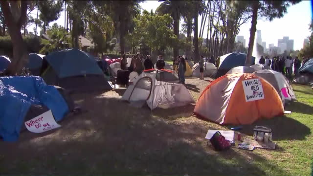 los angeles, ca, u.s. - homeless people's tents with placards in echo park on wednesday, february 12, 2020. - housing difficulties stock videos & royalty-free footage