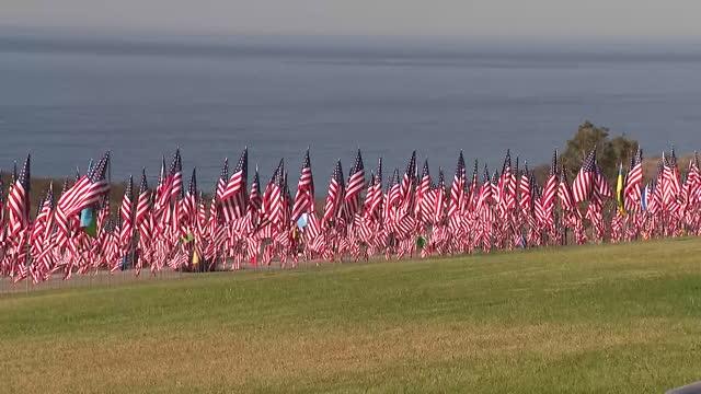 los angeles, ca, u.s. - hundreds of waving american flags at pepperdine university commemorating 9/11 attacks on saturday, september 11, 2021. - malibu stock videos & royalty-free footage