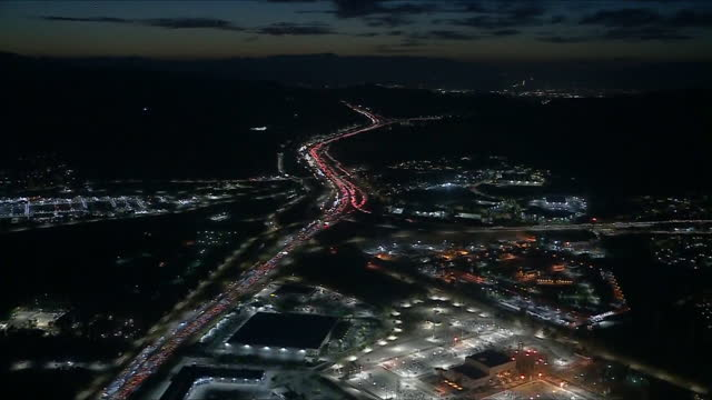 los angeles, ca, u.s. - interstate 5 at night, heavy traffic in san fernando valley, aerial view on friday, may 2021. - tail light stock videos & royalty-free footage