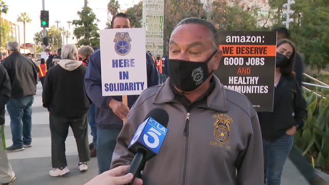 los angeles, ca, u.s. - interview with organizer of workers rally in support of unionizing alabama amazon workers, protesting union-busting, on... - gewerkschaft stock-videos und b-roll-filmmaterial