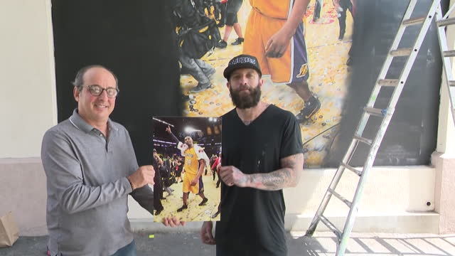los angeles, ca, u.s. - muralist jonas never working on a mural of kobe bryant and posing with photographer andrew d. bernstein in pasadena on... - male likeness stock videos & royalty-free footage