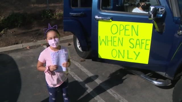 los angeles, ca, u.s. - people adorning their cars with protest messages. with some orange county schools on track to open for in-person learning... - costa mesa stock videos & royalty-free footage