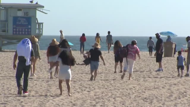 ktla los angeles ca us people enjoying summer weather on beach during coronavirus pandemic on sunday august 2 2020 - western script stock videos & royalty-free footage