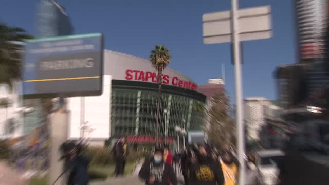 los angeles, ca, u.s. - people gathering at staples center to honor kobe bryant on anniversary of fatal helicopter crash, on tuesday, january 26,... - number 8 stock videos & royalty-free footage