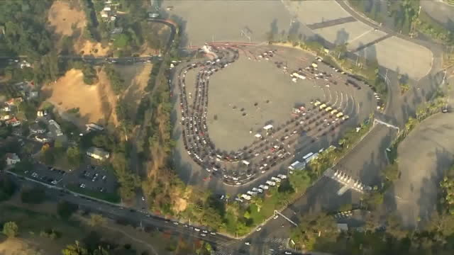 los angeles, ca, u.s. - people in cars queuing for covid-19 testing at dodger stadium - aerial view. on tuesday, november 24, 2020. - dividing line stock videos & royalty-free footage