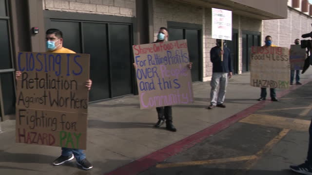 los angeles, ca, u.s. - people protesting at entrance to food 4 less against its planned closure over hazard, minimal pay, in long beach on... - long beach california video stock e b–roll