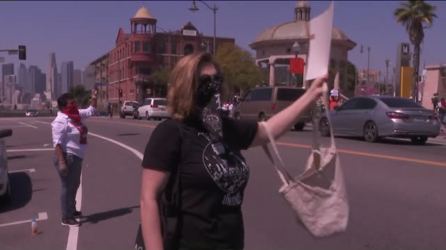 ktla los angeles ca us people protesting with placards and megaphones along street covid19 pandemic have led to a surge in unemployment tenants... - unemployment covid stock videos & royalty-free footage