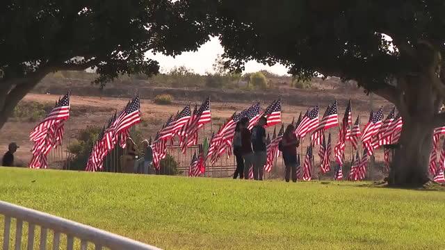 los angeles, ca, u.s. - people walking among american flags at pepperdine university campus commemorating 9/11 attacks on saturday, september 11,... - malibu stock videos & royalty-free footage