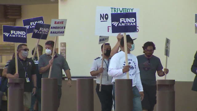 ktla los angeles ca us protestors carry posters during amtrak furlough protest on wednesday september 30 2020 a protest is underway against amtrak's... - furlough stock videos & royalty-free footage