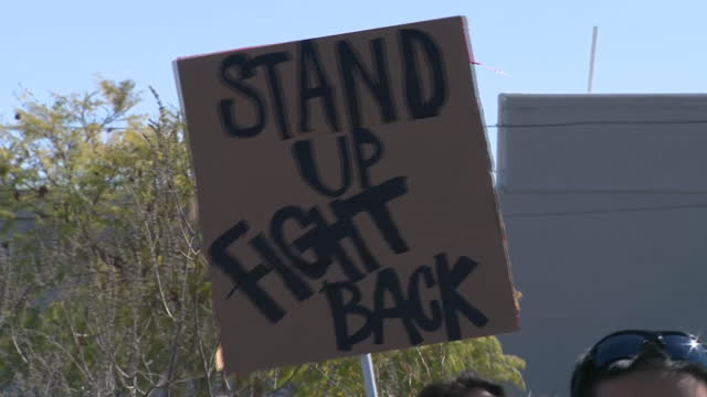 los angeles, ca, u.s. - protestors holding placards during rally in los angeles state historic park against attacks on asian american citizens.... - asian and indian ethnicities stock videos & royalty-free footage