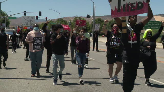 ktla los angeles ca us protestors with placards marching to protest the death of robert fuller a 24year old black man who was found hanging from a... - lynching stock videos & royalty-free footage