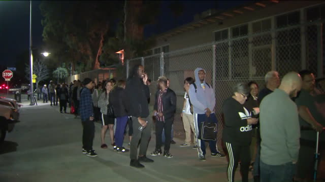 los angeles, ca, u.s. - scenes from polling place facing technical issues. problems plagued voting sites throughout state, including in nation's most... - waiting in line stock videos & royalty-free footage