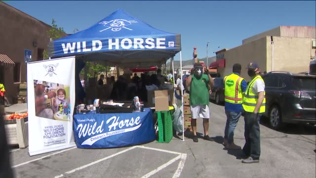 los angeles, ca, u.s. - stalls with food prepared to distribution by yasiel puig's foundation. yasiel puig's wild horse children's foundation, helmed... - sharing stock videos & royalty-free footage