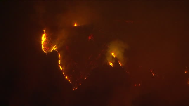 los angeles, ca, u.s. - the bobcat fire burning in the angeles national forest at night on monday, september 14, 2020. the fire has burned across a... - city of los angeles stock videos & royalty-free footage