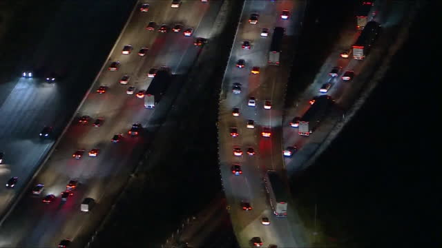 los angeles, ca, u.s. - traffic on interstate 5 in san fernando valley at night, aerial view on friday, may 2021. - tail light stock videos & royalty-free footage