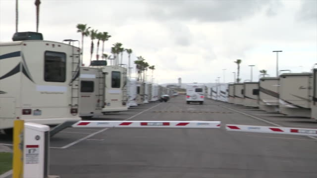 ktla los angeles ca us trailers parked in dockweiler beach in playa del rey which could become a location used for temporary housing to quarantine... - boom barrier stock videos & royalty-free footage