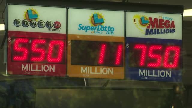 los angeles, ca, u.s. - view through window at sign showing lottery big prizes. on wednesday, january 13, 2021. - lottery stock videos & royalty-free footage