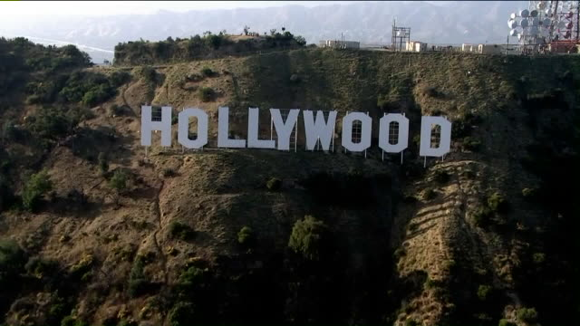 los angeles, california, u.s. - aerial view of hollywood sign, on wednesday, june 26, 2019. - hollywood sign stock videos & royalty-free footage