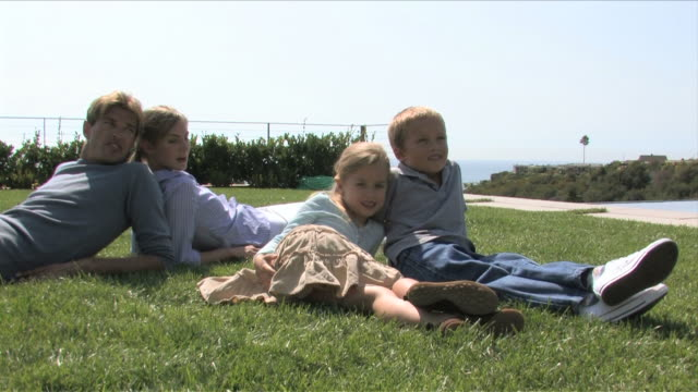 Los Angeles, California, USAParents and two kids are in the garden