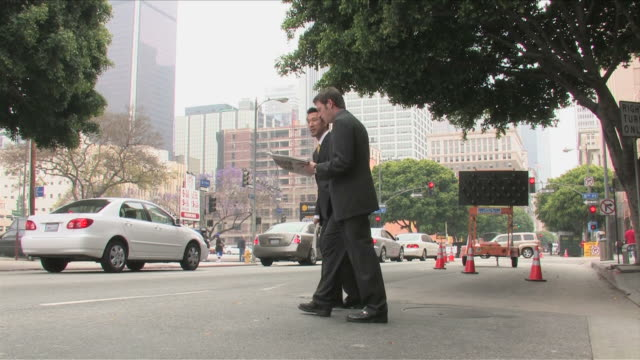 Los Angeles, California, USATwo business men are crossing the street
