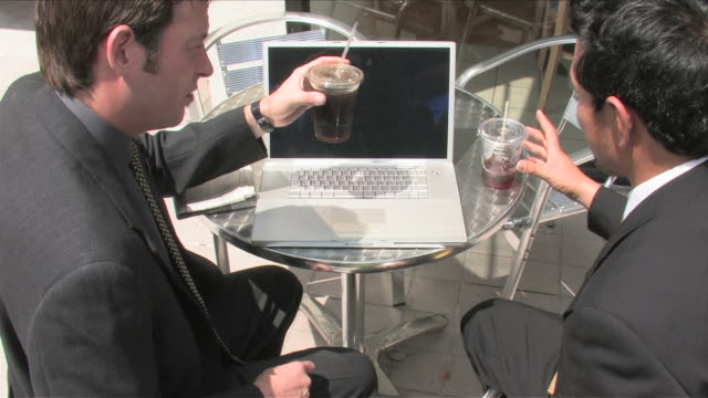 Los Angeles, California, USATwo business men are using the laptop