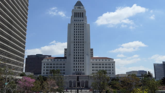 los angeles city hall an art deco building in downtown los angeles midday blue sky with some puffy clouds - midday stock videos & royalty-free footage