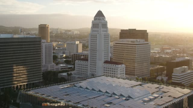 los angeles city hall at sunrise - aerial - courthouse stock videos & royalty-free footage