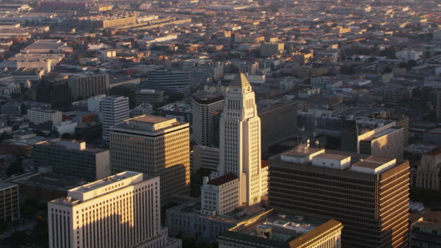 aerial los angeles city hall building at sunset - government building stock videos & royalty-free footage