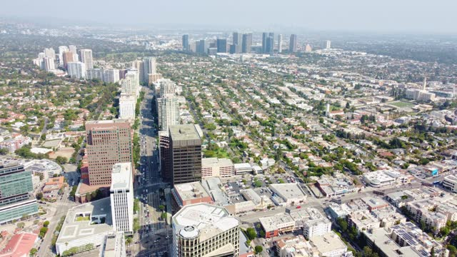 los angeles cityscape- aerial view of wilshire blvd, los angeles, california with view of west la- westwood  and century city - westwood neighborhood los angeles stock videos & royalty-free footage
