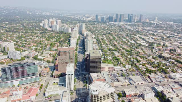 los angeles cityscape- aerial view of wilshire blvd, los angeles, california with view of west la- westwood  and century city. - westwood neighborhood los angeles stock videos & royalty-free footage