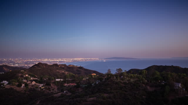 los angeles cityscape from malibu - day to night time lapse - malibu stock videos & royalty-free footage