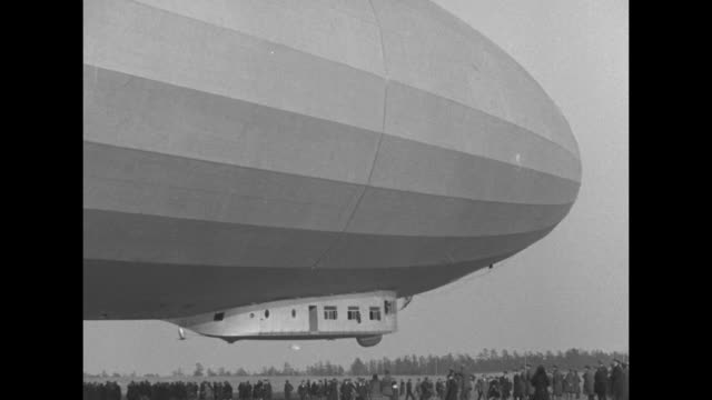 Los Angeles dirigible on field takes off people on ground nearby / Note Exact month/day not known