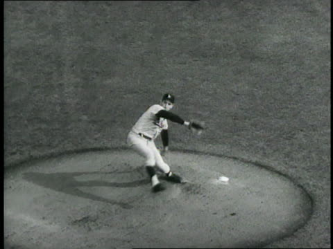 Los Angeles Dodgers pitcher Sandy Koufax pitches the ball and Minnesota Twins batter Bob Allison strikes out during game seven of the World Series