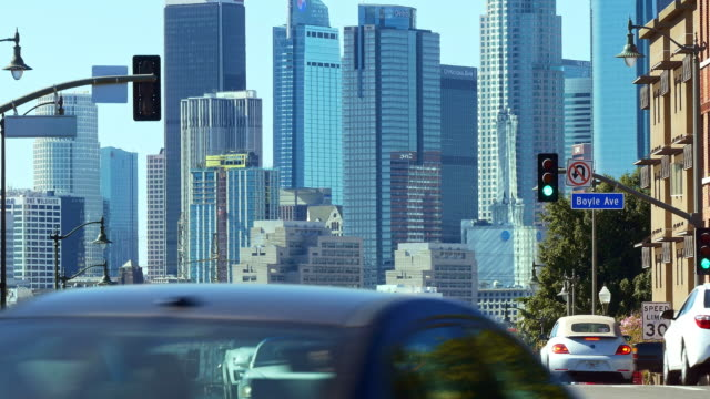 los angeles downtown financial and business towers skyscrapers skyline and traffic during rush hour, california, 4k - other stock videos & royalty-free footage