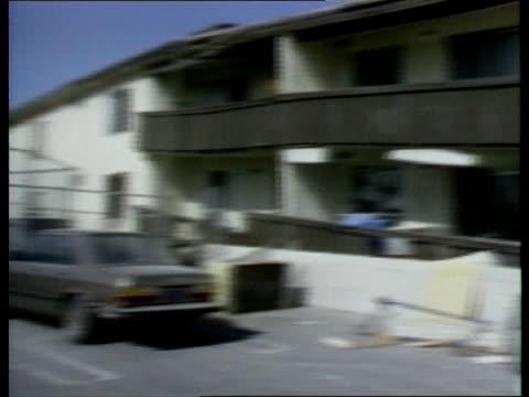 los angeles earthquake; b) nat: usa: california: los angeles: san fernando valley: northridge: ext gv apartment block gv line of damaged apartments... - northridge stock videos & royalty-free footage