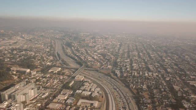los angeles freeway aerial shot - smog stock videos and b-roll footage
