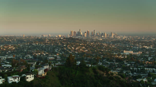 los angeles from over hollywood hills at sunset - aerial view stock videos & royalty-free footage