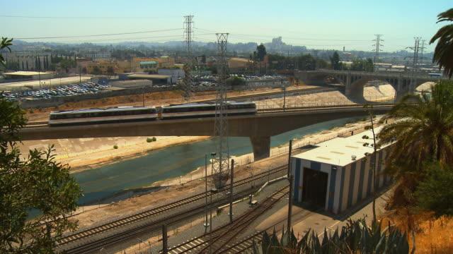 WS, HA, Los Angeles Gold Line commuter train crossing bridge, Los Angeles, California, USA