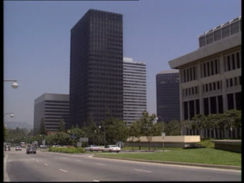 los angeles gvs fountains and office blocks in century city area gv cafe plaza slogan 'to protect and to serve' on side of police car bus decorated... - century city stock-videos und b-roll-filmmaterial