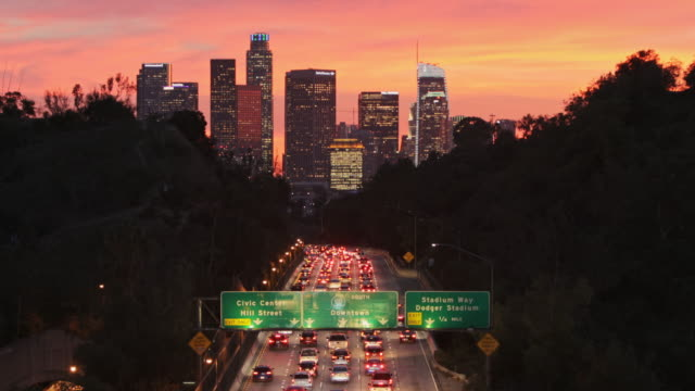 los angeles highways with rush hour traffic - city of los angeles stock videos & royalty-free footage