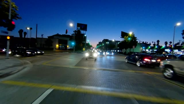 los angeles i synced series rear view driving process plate - street light stock videos & royalty-free footage